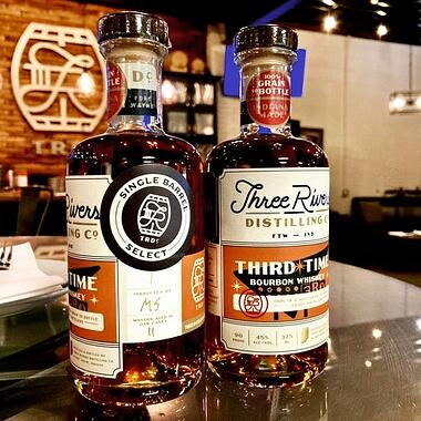 Two bottles of Three Rivers Distilling Third Time Bourbon side by side.