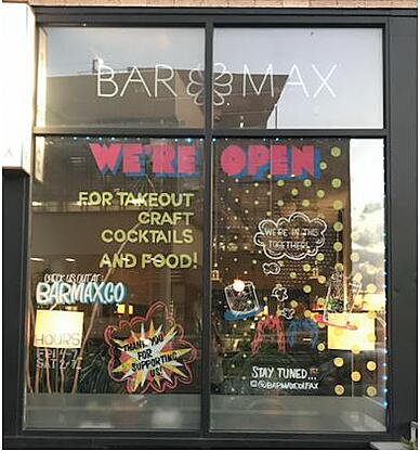 Bar Max's glass facade with the signage Bar Max written on the upper side of the glass door.